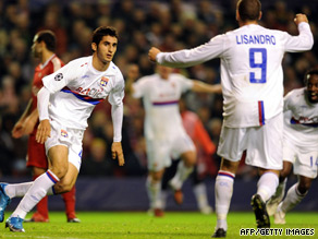 Maxime Gonalons (left) celebrates his equalizing goal as Lyon went on to stun Liverpool 2-1 at Anfield.