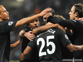 Antonio Valencia is congratulated by team-mates after scoring Manchester United's winner in Moscow.