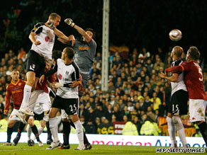 Fulham center-back Brede Hangeland rises highest to head home against Italian club Roma.