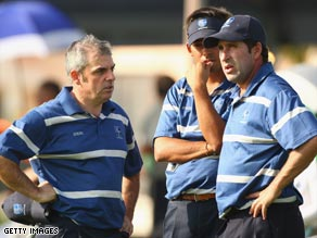 Olazabal (right) is deep in conversation with McGinley on the first day of the Royal Trophy.