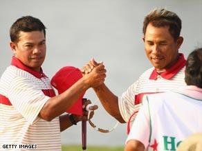 Thai duo Prayad Marksaeng (left) and Thongchai Jaidee celebrate their Royal Trophy victory.