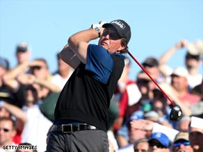 Mickielson tees off on the 11th watched by a big gallery at the TPC of Scottsdale.