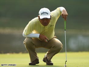 Chia weighs up a putt during his superb second round of 65 in Kuala Lumpur.