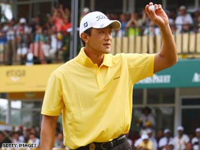 Kang celebrates after his birdie on the final hole gave him victory in the Malaysian Open.