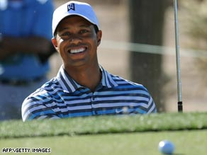 Woods is clearly enjoying himself as he lands a ball on the green from a bunker during his Match Play warm-up.