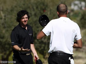 McIlroy (left) shakes hands with Ogilvy after the Australian wraps up a 2&1 win.