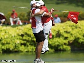 South Korean Ji-Yai Shin is swept off her feet by her caddie after winning the Women's Champions tournament.