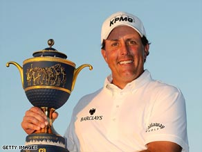 Mickelson holds the winning trophy aloft after a last-day battle in Florida.