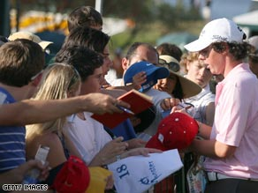 Rory McIlroy signs autographs at the World Golf Championships-CA Championship in Doral, Florida.
