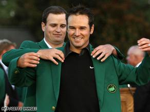 2007 Masters champion Zach Johnson puts the green jacket on 2008 winner Trevor Immelman.
