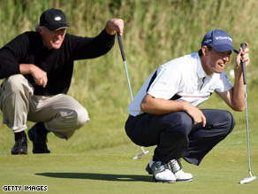 Padraig Harrington (right) and Greg Norman line up putts during the 2008 Open Championship at Royal Birkdale.