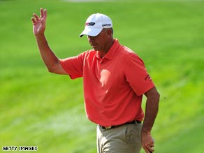 Lehman acknowledges the gallery after a successful birdie putt at Copperhead.