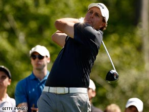 Mickelson tees off during his opening five-over 77 in Houston.