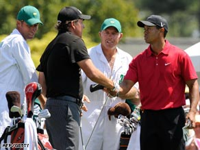 Mickelson (left) and Woods shake hands ahead of their momentous final rounds at Augusta.