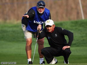 Austrian Markus Brier takes the advice of his caddie on his way to the China Open first round lead.