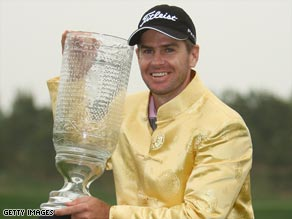 Scott Strange celebrates with the trophy after his one-shot victory at the China Open.