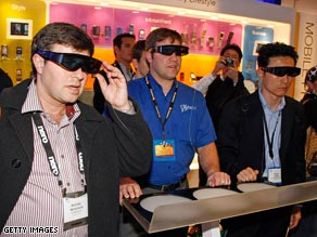 Attendees with special glasses watch 3D TV at the Consumer Electronics Show last week.