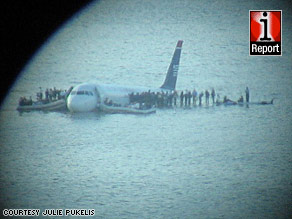 iReporter Julie Pukelis used a camera and a telescope to get this view of the scene in Hudson River.