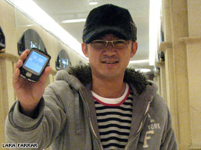 Shi Rui Huan, aka, 'the 3G guy' shows off his 3G phone. Will millions of other Chinese follow his lead?