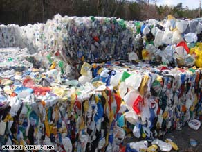 Lynn Heinisch takes her recyclables to a dropoff center miles away because she's unhappy with city services.