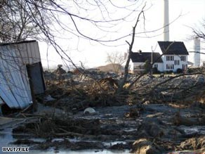 A Harriman, Tennessee, subdivision is swamped by coal ash sludge that spilled from a TVA pond in December.