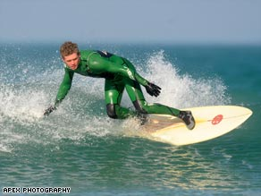 Surf's up: Mark Harris tries out the Eden eco-surfboard.