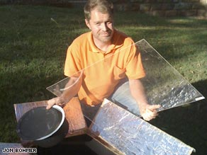 Inventor Jon Bohmer with the oven he has made out of a cardboard box.