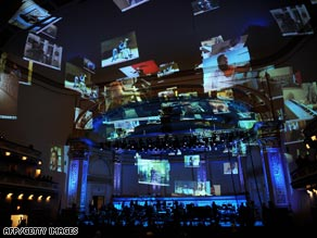 Images from musicians' videos are projected during the YouTube Symphony Orchestra concert in New York.