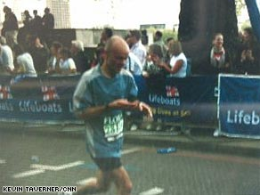 A blurry Pete Wilkinson texts from his cellphone as he runs in Sunday's London Marathon.