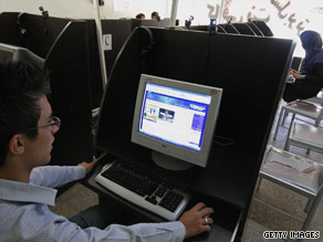 An Iranian youth reads a political blog in an Internet cafe.