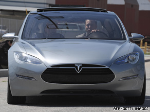 Tesla CEO Elon Musk behind the wheel of a Model S electric car in March.