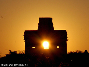 The sun shines through the door of the Seven Dolls Temple, in the Maya ruins of Dzibilchaltun in Mexico.