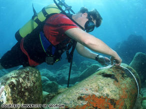 James Porter measures a 2,000-pound Navy bomb in the waters off the Caribbean island of Vieques.