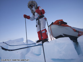 An explorer ventures out on a sheet of melting ice during the trek to the North Pole.