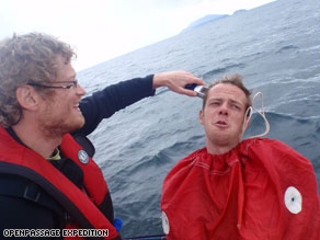 High seas high jinx: Tobias gives his shipmate Hanns a haircut at sea using a sail bag as a barber cape.