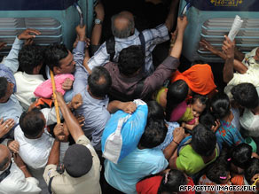 Riders cram into a train last month in New Delhi, India. India's population is expected to be 1.7 billion by 2050.