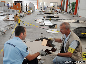 Investigators pore over wreckage of Air France flight 447 which crashed killing 228 people on June 1.