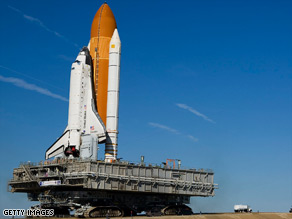 Discovery moves atop the crawler transporter in Cape Canaveral, Florida, on January 14.
