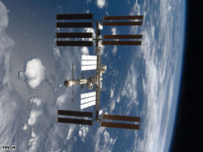 NASA says debris won't threaten the international space station, seen here from Endeavour in November 2008.