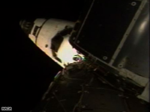 The orbiter Discovery docked with the international space station at 5:21 p.m. ET Tuesday, NASA said.