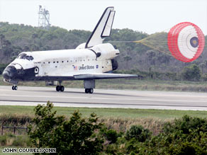 The space shuttle Discovery lands Saturday after a 13-day, 5.3-million-mile trip.