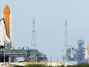 Shuttles Atlantis, left, and Endeavour sit on the launch pad in Cape Canaveral, Florida.