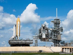 The space shuttle Discovery is brought by crawler to its pad at Cape Canaveral, Florida, on August 4.