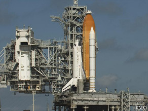 Discovery rests on launch pad 39A at Cape Canaveral on Monday evening.