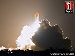 Space shuttle Discovery lifts off late Friday from Kennedy Space Center in a photo from iReporter Alan Walters.