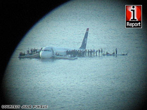 iReporter Julie Pukelis used a camera and telescope to get this view of the crash scene in the Hudson River.