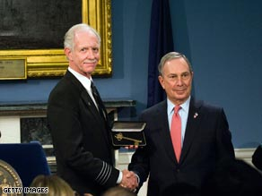 "Capt. Chesley ""Sully"" Sullenberger, left, shakes hands Monday with New York Mayor Michael Bloomberg."