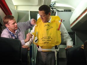 CNN's Richard Quest tries on a lifejacket at the British Airways Flight Training Centre.