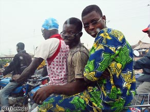 Locals get about in traffic heavy Lagos on motorcycles, known locally as okadas.