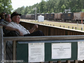 Folkston, Georgia, built a viewing platform in 2001 with a scanner to alert railfans for oncoming trains.